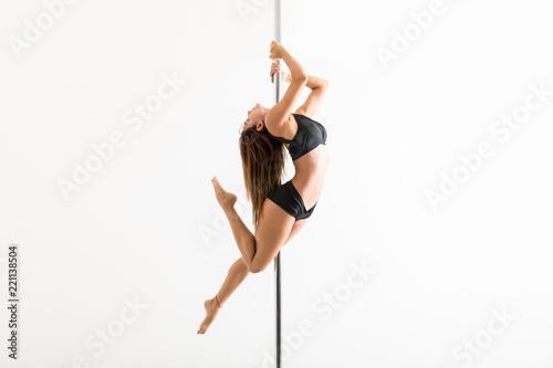 Obraz na plátně Pole Fitness Expert Flaunting Dance Moves In Studio