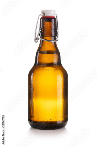 Small closed brown swing top bottle isolated on white background