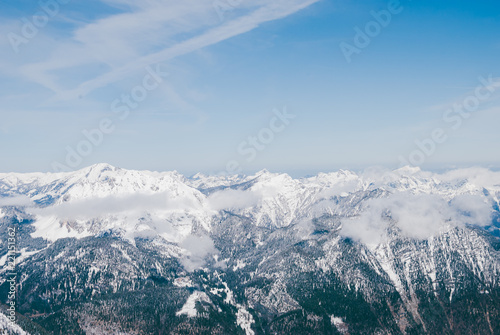 Keuken foto achterwand Alpen White snowy mountaon peaks. Sunny blue landscape in Austrian Alps. Clouds flying over the summits