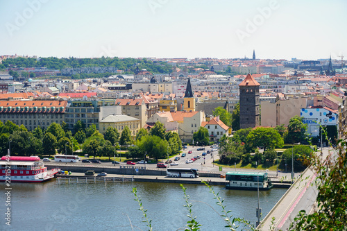 Foto  View of Prague with Vltava with ships and amazing buildings with red roofs