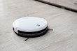 Robot vacuum cleaner on laminate floor cleans new cleaning and cleaning technologies