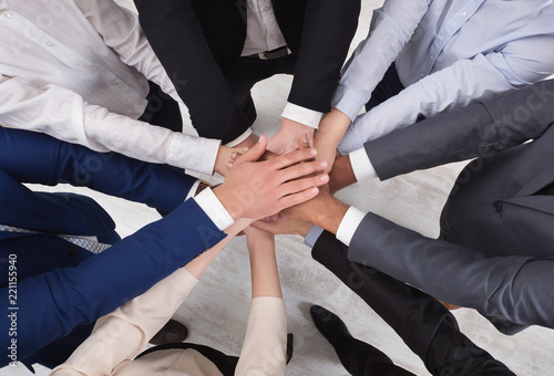 Fotografía  Top view of young business people hands