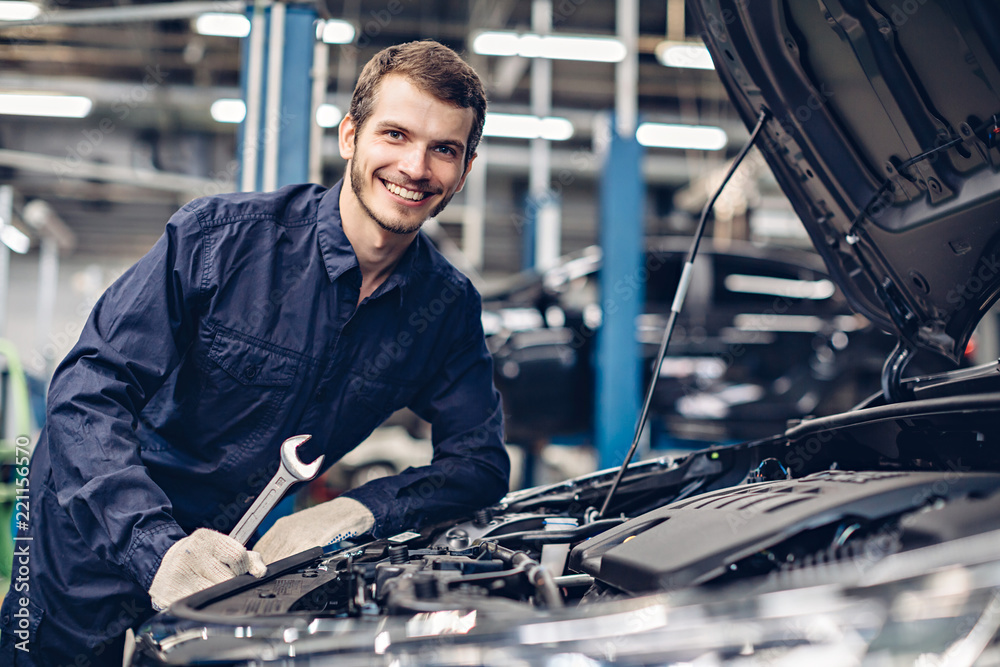 Fototapety, obrazy: Auto car repair service center. Mechanic examining car engine