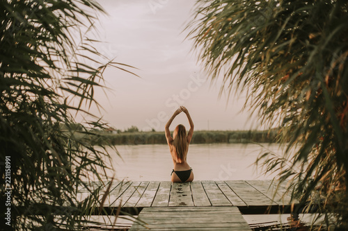 Poster Lieu connus d Asie Young woman in bikini on pier by river