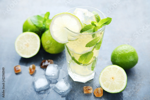 Spoed Foto op Canvas Cocktail Mojito cocktail in glass with sugar on wooden table