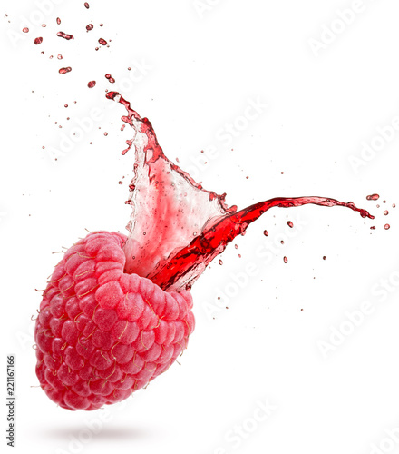 red juice splashing out of a raspberry isolated on white background.