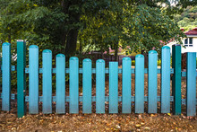 Blue Fence Gate  At A Yard In The Fall