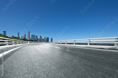 Poster Taupe asphalt highway with modern city in chicago