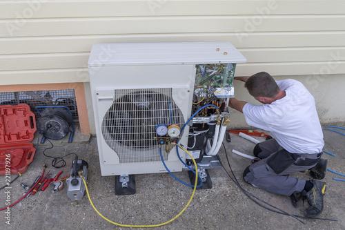 heat Pump. plumber at work installing a circulation heat pump Fotobehang