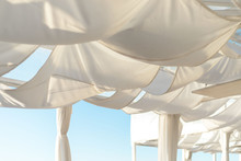 Awnings In The Form Of Sails On The Terrace, White Fabric