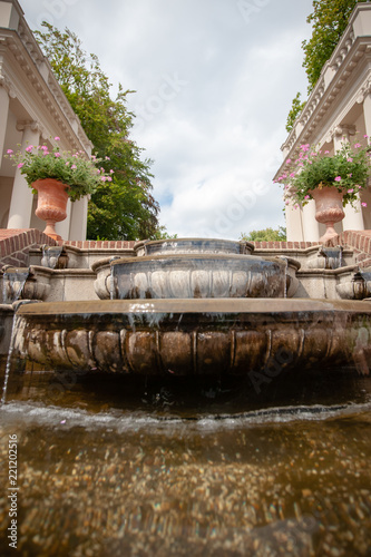 Billede på lærred Waterfall or fountain with Colonnades on both sides in a baroque garden
