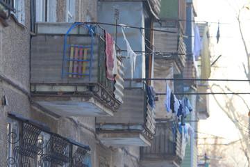 Fototapeta na wymiar balconies near old storey houses