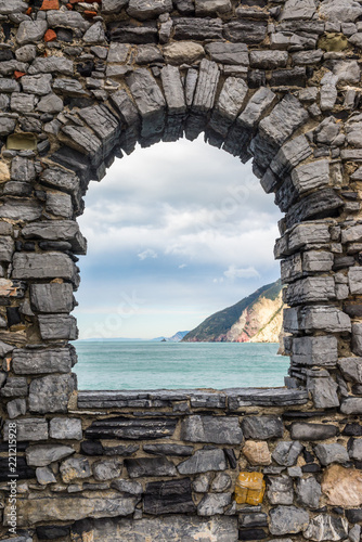 Sea view from a stone window of an old ruin castle wall in Portovenere, Liguria, Italy Canvas Print