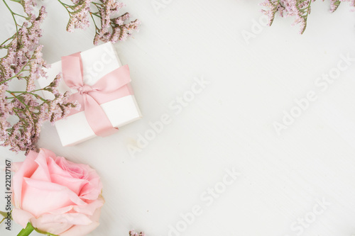 Rose fresh flower with gift box on table from above with copy space