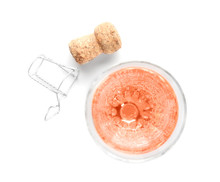 Glass Of Rose Champagne And Cork Plug On White Background, Top View