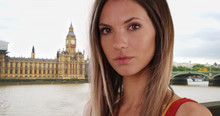 Close-up Portrait Of Brunette With Wind Blowing Hair By Big Ben In London