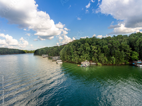 Fotografia, Obraz Aerial view of waterfront properties and boat docks in Lake Lanier
