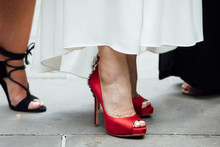 A Bride's Red High-heeled Shoes During An Urban City Wedding