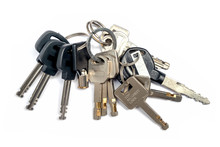 Bunch Of Many Keys Lies On An ISolated White Background