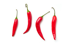 Red Chili Pepper On A White Ba...