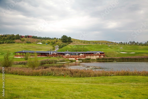 Foto  beautiful meadow and lake/golf course