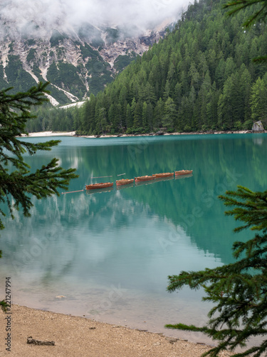 Tuinposter Meer / Vijver Beautiful view of lake Braies with wooden boats on the water, surrounded by dolomites mountains. Trentino alto adige, Italy. August, 2018