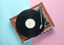 Vinyl Player On A Blue Pink Pa...