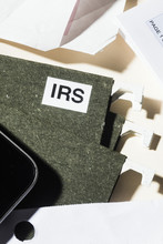 Close Up IRS Taxes File And Finance Paperwork