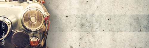 The headlight of the old beautiful car on the background of a concrete wall. Copy space. Concept banners repair, sale of cars. - 221269172