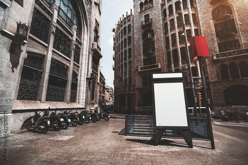 Fotografie, Obraz  Vertical empty billboard placeholder template on the street with multiple motorb