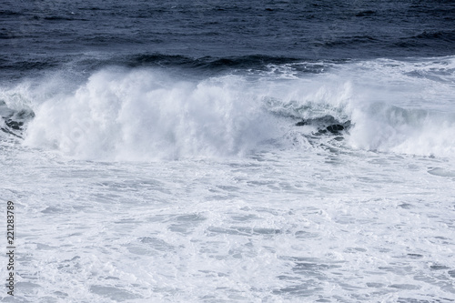 Spoed Foto op Canvas Water Stormy clouds and crashing ocean waves during storm in the atlantic ocean