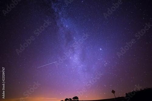 Foto auf Gartenposter Nordlicht Shooting Stars Crossing in Milky Way and Starry Sky before Dawn.