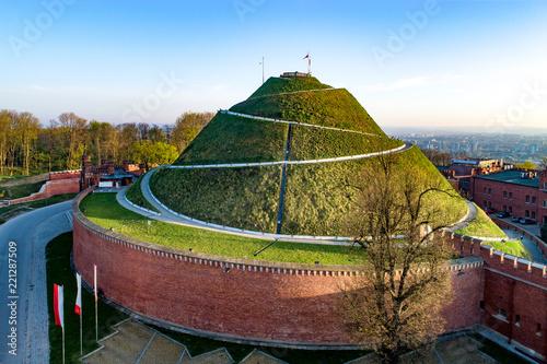 Fototapeta Kosciuszko Mound (Kopiec Kościuszki). Krakow landmark, Poland. Erected in 1823 to commemorate Tadedeusz Kosciuszko. Surrounded by a citadel built by Austrian Administration about 1850. Aerial view obraz