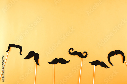 Obraz Movember concept. Annual event involving growing of moustache & beard during month in November to raise awareness of men's health issues and prostate cancer. Background, close up, copy space, flat lay - fototapety do salonu