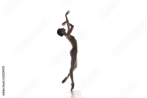 Young graceful female ballet dancer or classic ballerina dancing isolated on white studio Fototapet