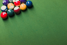 Close Up Of Pool Billiards Snooker Balls On Green Table With Setup Position.