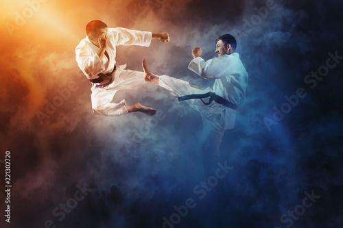 Spoed Foto op Canvas Vechtsport Two male karate fighting