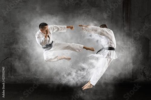 Foto auf Leinwand Kampfsport Two male karate fighting