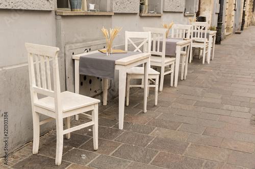 Terraza De Bar Con Mesas Y Sillas Blancas Buy This Stock