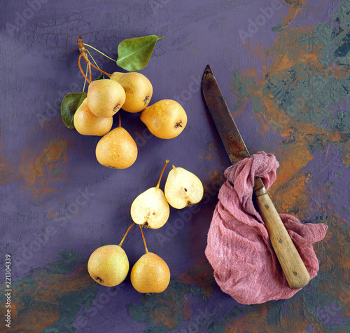 Fresh pears decorated on rustic dark shabby chic table, can be used as background