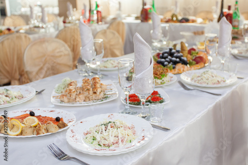 Staande foto Buffet, Bar Restaurant table with snacks food at event.