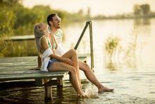 Romantic Couple Sitting On The...
