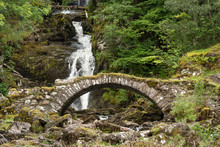 Ancient Roman Bridge And Waterfalls At Glen Lyon, Perthshire, Scotland.