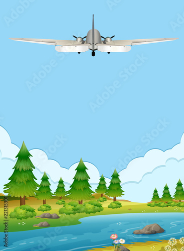Airplan flying over the forest