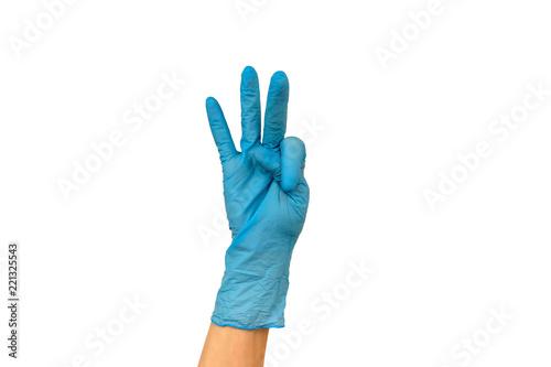 Fotografija  woman's hand in a rubber glove
