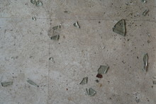 Shards Of Broken Glass On The Tiled Floor