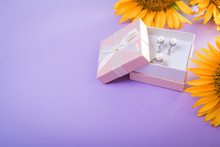 Set Of Pearl Jewellery In The Gift Box With Sunflowers