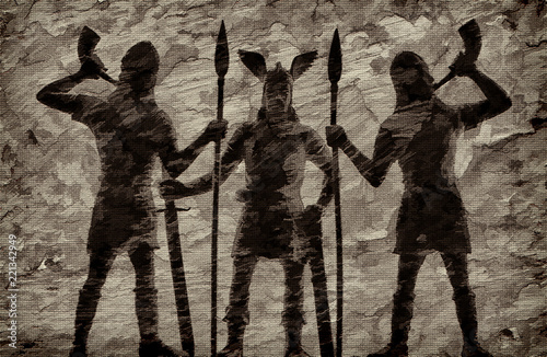 Photo  Old Norse God Odin with a long sword in his hand and two guards-spearmen trumpet