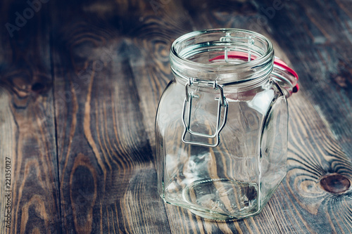 Empty glass jar on a wooden table - utensils for food Tableau sur Toile