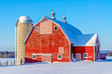A Red Barn In A Minnesota Winter Landscape